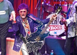 Jim Peterik rocking the house during a Cornerstones Of Rock concert.  Photo by Kristie Schram.